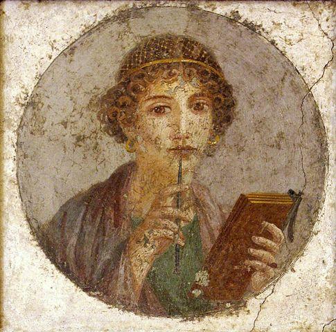 A tanult nő (Nő írótollal és táblával). Festmény Pompeii-ből kb. i. sz. 50-ből. Forrás: Wikipédia